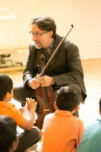 Norman Hathaway working with the students at Rose Ave. Jr. P.S.