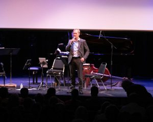 Pre-concert, Fredrik Alatalo, Chief Administrative Officer telMAX, addressing the audience. Photo by Marion Voysey
