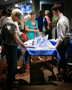 Post-concert, Euterpe Officer John Nicholson selling Ensemble Vivant CDs to interested audience members. Photo by Marion Voysey