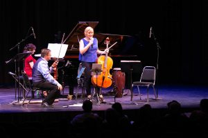 Ensemble Vivant's cellist Sybil Shanahan speaking to audience; Corey Gemmell, violin; Catherine Wilson, piano. Photo by Marion Voysey