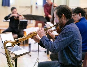 Ensemble Vivant in performance for the kids; Perry White, sax