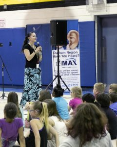 Dr. C. F. Cannon Music Teacher Melissa Warner introducing Euterpe musicians to the kids. Photo by Marion Voysey