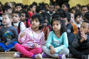 Young audience members captivated by the live performance.