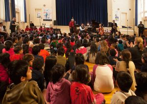 Euterpe and Reaching Out Through Music Collaboration on Dec. 22, 2017 at Rose Ave. Jr. P.S. in St. James Town, Toronto. Assistant Choral Conductor Laura Packer with the St. James Town Children's Choir performing during the early afternoon for over 500 young students. Photo by Slav Kov