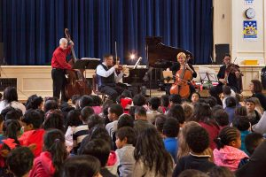 Ensemble Vivant performing for over 500 young students. Jim Vivian, bass; Corey Gemmell, violin; Catherine Wilson, piano; Sybil Shanahan, cello; Norman Hathaway, viola