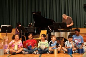 Students thrilled to perform with pianist Catherine Wilson and vibraphonist Don Thompson (coffee tins substituted for drums as that was what the school had)