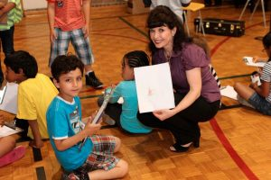 Pianist Catherine Wilson interacting with young student