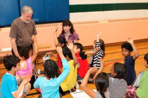 Engaged young students interacting with vibraphonist/basssist Don Thompson and pianist Catherine Wilson