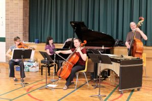 Ensemble Vivant enjoying performing for the students