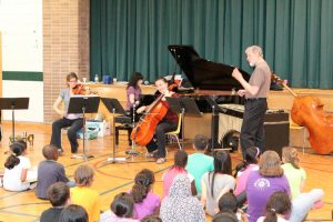 Don Thompson, vibes/bass, standing, interacting with the students during Ensemble Vivant's performance