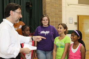 Euterpe's President Norman Hathaway interacting with engaged, inspired students
